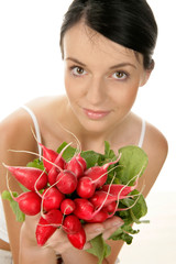 Young woman with bunch of radishes