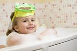 Fototapety Cute girl playing in foam