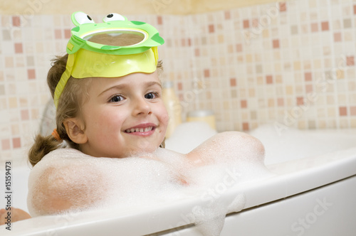 Cute girl playing in foam