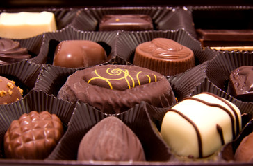 Chocolate bonbons in box, closeup
