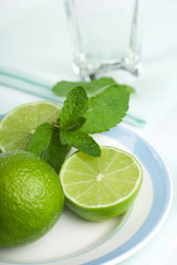limes and mint on plate