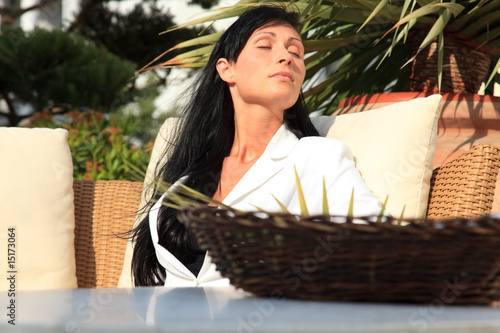 stressed business woman relaxing outdoor with closed eyes