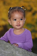 Toddler girl in purple
