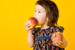 Little girl with two apple