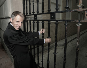 Businessman trying to open the gate