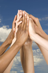 Group of Hands Coming Together