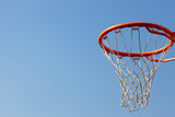 Basketball hoop against blue skies. concept for aspiration poster