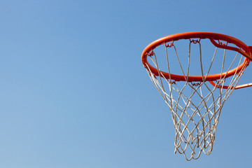 Basketball hoop against blue skies. concept for aspiration