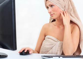 towel pampered woman working on computer