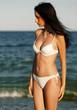 Young girl in bikini at seaside