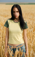Glamour girl in summer corn field