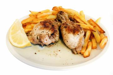 Cosce di pollo al limone con contorno di patatine fritte