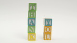 Wooden alphabet blocks spell out THANK YOU