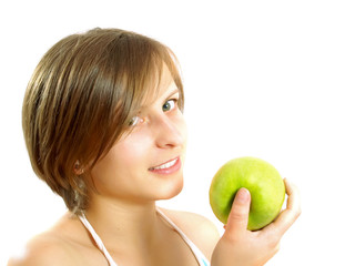 Attractive girl holding a green apple