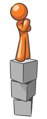 Design Mascot Standing on Blocks