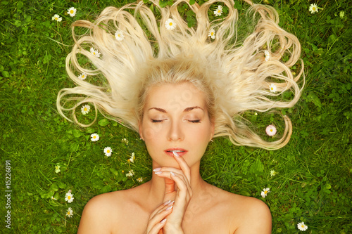 Young woman relaxing on a meadow....