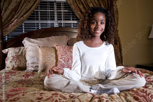 cute 10 year old african american girl sitting on bed stock photo and royalty free images on. Black Bedroom Furniture Sets. Home Design Ideas