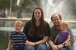 Family of 4 with fountain behind
