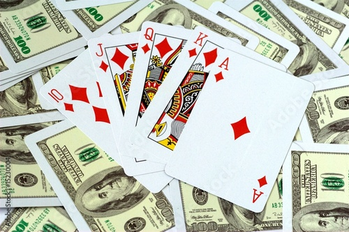 Royal Flush of Diamonds on money background