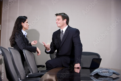 Young business executives conversing in boardroom