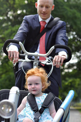 Business men riding his young child to creche