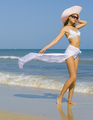 Girl on a beach, wind blowing