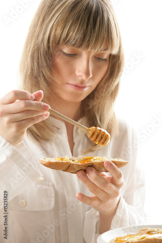 Young woman with honey and bread