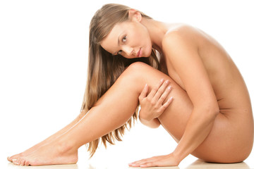Young beauty naked woman sitting