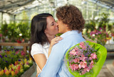 couple kissing in flower nursery poster