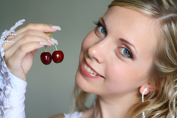 Beautiful bride with sweet cherry