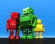 3 robots in bright colors