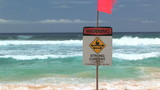 Warning strong current sign at Sandy Beach, Hawaii poster