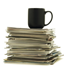 Mug on magazine stack
