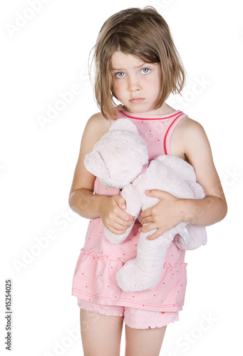 Shot of a Sad Blonde Child Holding her Teddy Bear