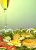 Pork rissole in tempura with greenery, vegetables and wina glass poster