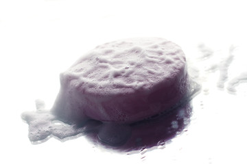 Purple soap and bubbles on a white background