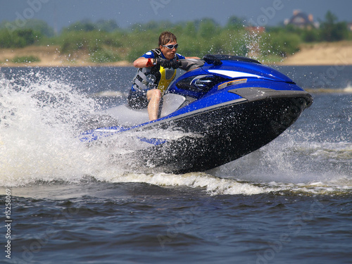 Staande foto Water Motorsp. Jumping man on jet ski