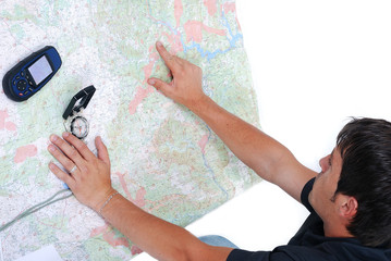 Man sitting and looking at maps in his hands