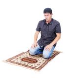 Muslim man is praying on traditional way poster
