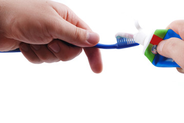 Dentifrice and brush in hands