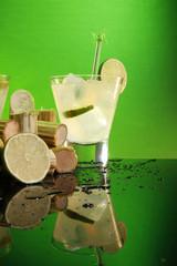 Caipirinha, whiskey sour or pisco sour with sugar cane and lime