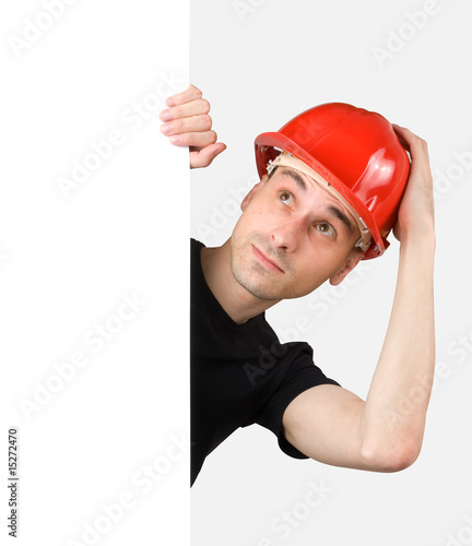 Construction worker with a blank sign. Isolated on white