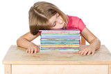 Isolated Shot of a Young Child Falling Asleep on her Books poster