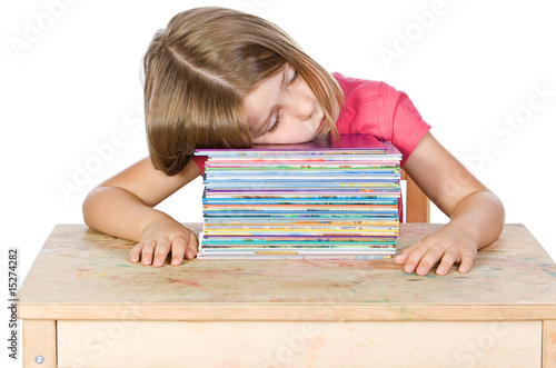 Isolated Shot of a Young Child Falling Asleep on her Books