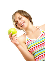 Smiling cute girl holding a green apple