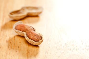 Peanuts on Wood Background