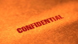 Confidential stamp on a manilla folder poster