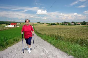 Senior woman doing Nordic walking