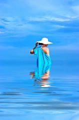 Lady in blue shawl on the beach