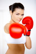 Young beautiful woman during fitness time and boxing